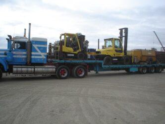 truck transporting bobcats