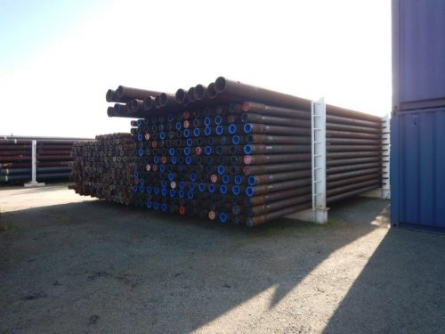 stacked pipes in storage